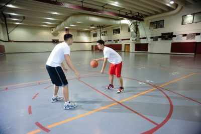 students play one-on-one basketball in War Memorial Hall