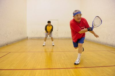 two men play racquetball in War Memorial Hall
