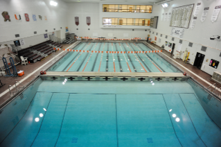 The gym includes a pool with 25-yard swimming lanes and a diving well.