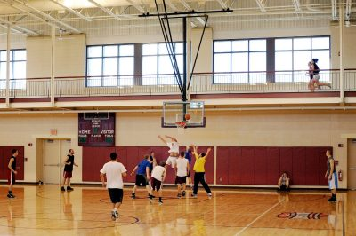 students play basketball in McComas Hall