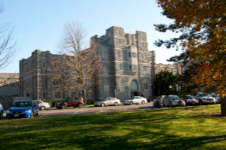 The building sits on the Drillfield, directly across from Burruss Hall.
